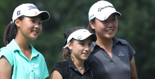 Choi, Pineda and Kim share a moment after the round